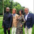 Kanye West, Valentino Garavani, Kim Kardashian et Giancarlo Giammetti au château de Wideville à Crespières, le 23 mai 2014.