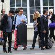 Mike Dean (casquette, à gauche) et les invités du mariage de Kim Kardashian et de Kanye West s'envolent de l'aéroport du Bourget pour Florence. Le Bourget, le 24 mai 2014.