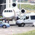 Kanye West et ses invités arrivent en jet privé à Florence, le 24 mai 2014.