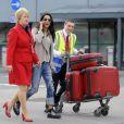 Amal Alamuddin, la fiancée de George Clooney arrivant à l'aéroport de Heathrow, Londres, le 13 mai 2014 avec de nombreux bagages en provenance des Etats-Unis.