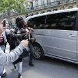 Rihanna quitte l'Hard Rock Cafe à Paris, le 5 juin 2014.