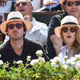 Antoine Arnault and Natalia Vodianova lors de la finale homme des Internationaux de France de tennis de Roland-Garros à Paris, le 8 juin 2014.