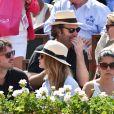 Antoine Arnault, Natalia Vodianova et Xavier Niel lors de la finale homme des Internationaux de France de tennis de Roland-Garros à Paris, le 8 juin 2014.