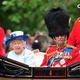 La reine Elizabeth II et le duc d'Edimbourg dans le landau Ascot lors de la parade Trooping the Colour marquant le 14 juin 2014 la célébration solennelle des 88 ans de la souveraine.