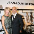 Lynda Lacoste et son compagnon Bruno Bensoussan à l'inauguration de la nouvelle boutique Jean-Louis Scherrer au 111, rue du faubourg Saint-Honoré à Paris, le 19 juin 2014.