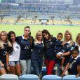 Jennifer Giroud, Ludivine Sagna, Sandra Evra, Fanny, la compagne de Loïc Rémy, Elodie Mavuba et ses enfants, Fiona Cabaye lors du match de l'équipe de France face à l'Equateur, le 25 juin 2014 au stade Maracanã de Rio