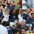 Fanny Rémy, Fiona Cabaye, Mazda Sakho, Ludivine Sagna et son fils Lenny, Sandra Evra lors du match de l'équipe de France face à l'Equateur, le 25 juin 2014 au stade Maracanã de Rio