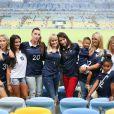 Jennifer Giroud, Ludivine Sagna avec son fils Lenny et sa fille Uma, Sandra Evra, Fanny, la compagne de Loïc Rémy, Elodie Mavuba, Fiona Cabaye lors du match de l'équipe de France face à l'Equateur, le 25 juin 2014 au stade Maracanã de Rio