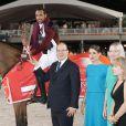 Le prince Albert II de Monaco et Charlotte Casiraghi remettent le Grand Prix du Prince de Monaco au Qatari Bassem Hassan Mohammed - Jumping international de Monte-Carlo - Longines Global Champions Tour, le 28 juin 2014.