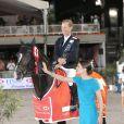 Charlotte Casiraghi et un cavalier - SAS le prince Albert II de Monaco et Charlotte Casiraghi remettent le Grand Prix du Longines Global Champions Tour de Monaco au vainqueur du Qatar, Bassem Hassan Mohamed le 28 Juin 2014 à Monaco