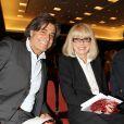 """Alexandre Zouari, Mireille Darc - Vente aux enchères """"Les Coeurs des Créateurs"""" chez Christie's au profit de la Chaîne de l'Espoir à Paris le 3 juillet 2014."""