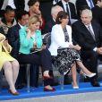 La maire de Paris Anne Hidalgo et Claude Bartolone, président de l'Assemblée nationale - Défilé pour la Fête nationale sur les Champs-Elysées en hommage aux sacrifice des troupes alliées dans la Première Guerre mondiale il y a cent ans. Le 14 juillet 2014.