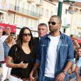 Tony Parker et sa fiancée Axelle Francine dans les rues de Saint-Tropez, le 1er juillet 2014