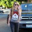 Emma Roberts sort du coiffeur à West Hollywood, le 4 août 2014.