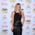 Hilary Duff arrive au Shrine Auditorium pour les Teen Choice Awards 2014, habillée d'un top Sachin & Babi, d'une jupe en cuir et de souliers Stuart Weitzman. Los Angeles, le 10 août 2014.