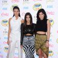 Kendall Jenner, Kim Kardashian et Kylie Jenner arrivent au Shrine Auditorium pour les Teen Choice Awards 2014. Los Angeles, le 10 août 2014.