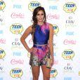 Nina Dobrev arrive au Shrine Auditorium pour les Teen Choice Awards 2014, habillée d'un ensemble top et short Vionnet, d'une pochette Michael Kors et de chaussures Kurt Geiger. Los Angeles, le 10 août 2014.