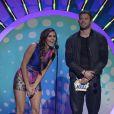 Nina Dobrev et Kellan Lutz présentent le prix d'actrice de l'année dans un film d'action/aventure lors des Teen Choice Awards 2014. Los Angeles, le 10 août 2014.