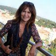 Exclusif - Clémentine Célarié pose à l'hôtel Aston à Nice, le 1er août 2014