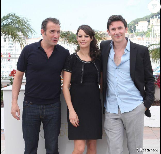 Jean Dujardin, Bérénice Bejo et Michel Hazanavicius lors du photocall du film The Artist au Festival de Cannes 2011