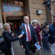 Arnold et Loïs Pistorius à la sortie de la North Gauteng High Court de Pretoria le 12 septembre 2014