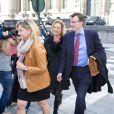 Delphine Boël, fille illégitime supposée du roi Albert II de Belgique, arrive au tribunal de première instance de Bruxelles le 2 octobre 2014 avec son avocat pour l'audience au cours de laquelle le ministère public a rendu son avis concernant sa demande de reconnaissance en paternité visant l'ancien souverain.