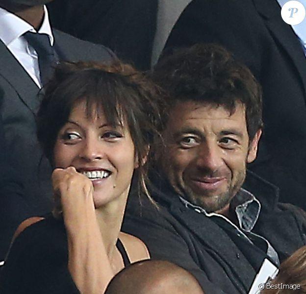 Patrick Bruel et sa compagne Caroline - Match PSG-Barcelone de la Ligue des Champions au parc des princes à Paris le 30 septembre 2014. Le PSG à remporté le match sur le score de 3-2.