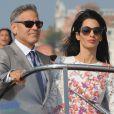 George Clooney et sa femme Amal Alamuddin quittent l'hôtel Aman, où ils ont passé leur nuit de noces à Venise, le 28 septembre 2014, pour se rendre à un brunch à l'hôtel Cipriani.