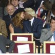 Satya Oblet et sa compagne lors du Qatar Prix de l'Arc de Triomphe à l'hippodrome de Longchamp à Paris, le 5 octobre 2014