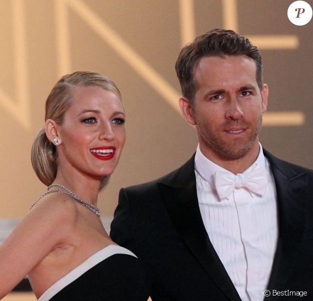 """Blake Lively et son mari Ryan Reynolds sur la montée des marches du film """"Captives"""" lors du 67e Festival du film de Cannes le 16 mai 2014"""