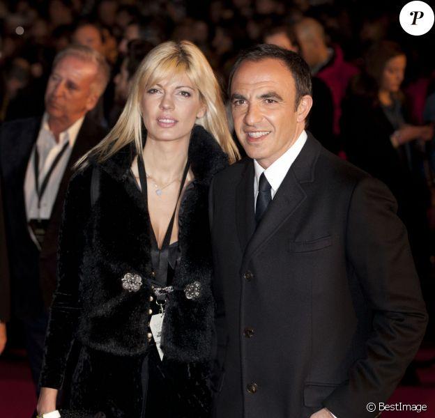 L'animateur Nikos Aliagas et sa compagne Tina Grigouriou - 15e édition des NRJ Music Awards à Cannes. Le 14 décembre 2013.