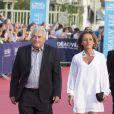 """Dominique Strauss-Kahn et sa compagne Myriam L'Aouffir - Avant-première du film """"Sin City"""" lors du 40e Festival du Cinéma Américain de Deauville, le 13 septembre 2014."""