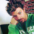 Vincent La Torre avec les cheveux bouclés mi longs sur son compte Instagram (été 2014).