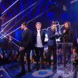 Les One Direction remportent le prix du Groupe-duo international de l'année, le samedi 13 décembre lors des NRJ Music Awards 2014.