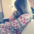 Khloé Kardashian et sa nièce Penelope au lendemain du réveillon de Noël de la famille Kardashian. Los Angeles, le 24 décembre 2014.