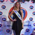 """Miss France 2015 Camille Cerf lors de l'émission de radio : """"La matinale Spéciale Noël sur RFM"""" dans les studios de RFM à Paris, le 19 décembre 2014."""