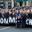 Les dirigeants politiques mondiaux, les membres de l'équipe de Charlie Hebdo et les familles des victimes défilent à la marche républicaine pour Charlie Hebdo à Paris le 11 janvier 2015
