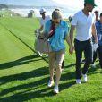 """La chanteuse Fergie et son mari Josh Duhamel assistent au tournoi de golf """"AT&T Pebble Beach National Pro"""" à Pebble Beach en Californie. Le 14 février 2015 14/02/2015 - Pebble Beach"""