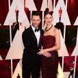 Adam Levine et Behati Prinsloo (robe Armani Privé, bijoux De Grisogono) à la 87e cérémonie des Oscars à Hollywood, le 22 février 2015.