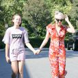 """Miley Cyrus et sa soeur Noah vont faire des courses à Los Angeles, le 29 juin 2014. Miley porte son nouveau petit chien Emu dans ses bras. Les deux soeurs se sont d'abord rendues dans une épicerie puis dans le magasin """"Bed Bath and Beyond"""". No web - No blog For Germany call for price Exclusive - Despite her scandalous on stage persona and untamed rockstar lifestyle, Miley Cyrus still takes time out to bond with her little sister as the two shop together in Los Angeles, California on June 28, 2014. With her cute new Rough Collie pup Emu under her arm and clad in Chanel accessories, Miley is all smiles as she shops with 14 year old Noah at the grocery store and then Bed, Bath and Beyond. The Cyrus sisters picked up a pizza maker, cutting board and juice dispenser among other goodies.29/06/2014 - Los Angeles"""