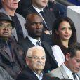 Eric Abidal et sa femme Hayet lors de la rencontre entre le Paris Saint-Germain et le FC Barcelone en quart de finale de la Ligue des champions, le 15 avril 2015 au Parc des Princes à Paris