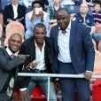 Eric Abidal, Jocelyn Angloma et Basile Boli lors de la rencontre entre le Paris Saint-Germain et le FC Barcelone en quart de finale de la Ligue des champions, le 15 avril 2015 au Parc des Princes à Paris