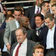 Nicolas Sarkozy et Monica Bellucci lors de la rencontre entre le Paris Saint-Germain et le FC Barcelone en quart de finale de la Ligue des champions, le 15 avril 2015 au Parc des Princes à Paris
