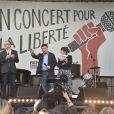 """Daphné Bürki, Christophe Deloire (secrétairegénéral de RSF) et Wu'er Kaixi (un des leaders étudiants des manifestations de la place Tian'anmen en 1989) - Reporters Sans Frontières (RSF) organise pour ses 30 ans """"Un concert pour la liberté"""" pour célébrer la Journée Mondiale de Liberté de la Presse sur la place de la République à Paris, le 3 mai 2015."""