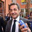 Nicolas Sarkozy, nouvellement élu à la présidence de l'UMP, visite un centre d'affaires avec Eric Ciotti et Christian Estrosi, où des start up travaillant sur les nouvelles technologies sont installées, à Nice, le 22 avril 2015.