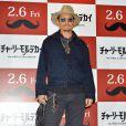"Johnny Depp pose lors du photocall du film ""Charlie Mortdecai"" à Tokyo, le 28 janvier 2015."