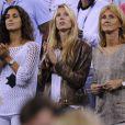 Xisca Perella, Isabel Nadal et Maria Parera, les compagne, soeur et mère de Rafael Nadal lors du second tour de l'US Open, à Flushing Meadows, à New York, le 29 août 2013