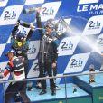 Patrick Dempsey, sous une douche de champagne, après avoir terminé à la seconde place des 24 Heures du Mans en catégorie GT Am, le 14 juin 2015 au Mans, sur le Circuit des 24 Heures