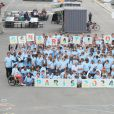 Anne Hidalgo entourée d'enfants sur les quais de Seine à Paris le 23 juin 2015 à l'occasion de la candidature de la France à l'organisation des Jeux olympiques de 2024