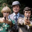 Joanna Lumley (Purdey), Patrick MacNee (John Steed) et Gareth Hun (Mike Gambit) durant le tournage de Chapeau melon et bottes de cuir à Londres (archives)